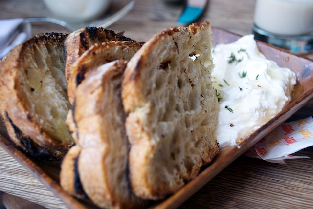 Sheeps' milk ricotta with burnt orange toast at Locanda Verde.jpg
