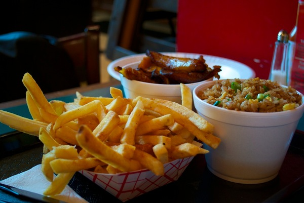 French fries, fried plantains, seasoned rice at Sardi's.jpg