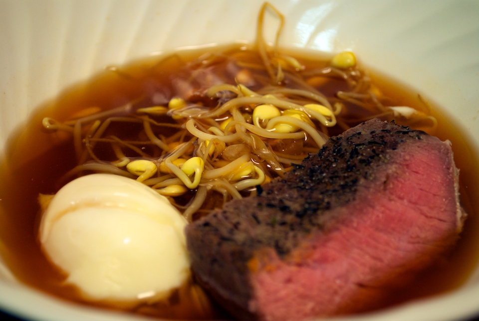 Sous vide beef with perfect poached egg and beansprouts in beef broth