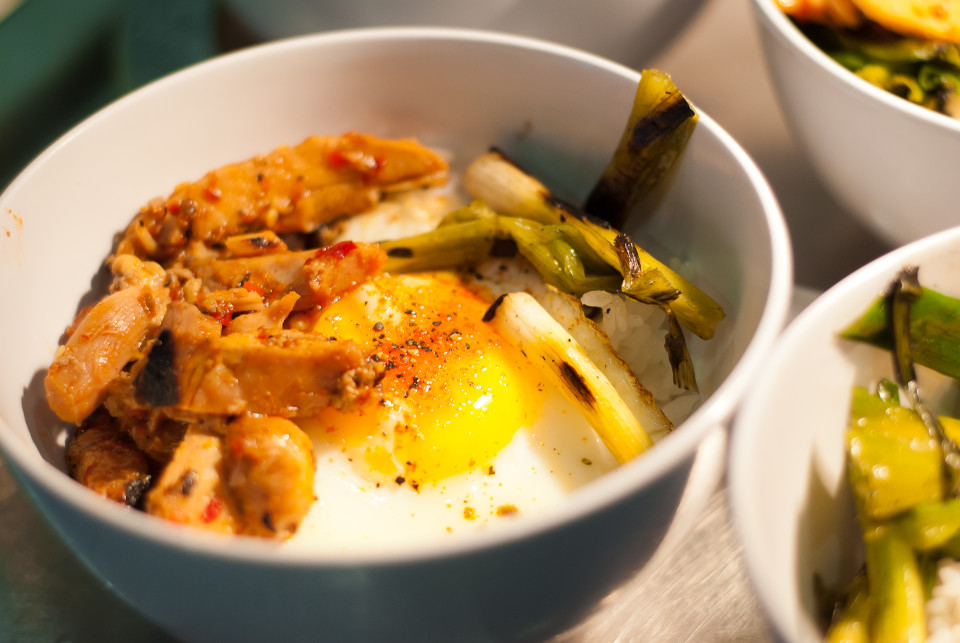 A glutinous white rice bowl with Spanish chicken, lightly fried quail egg, and sauteed green onions. The salty and savory mix brought featured a few, excellent, pure flavors.